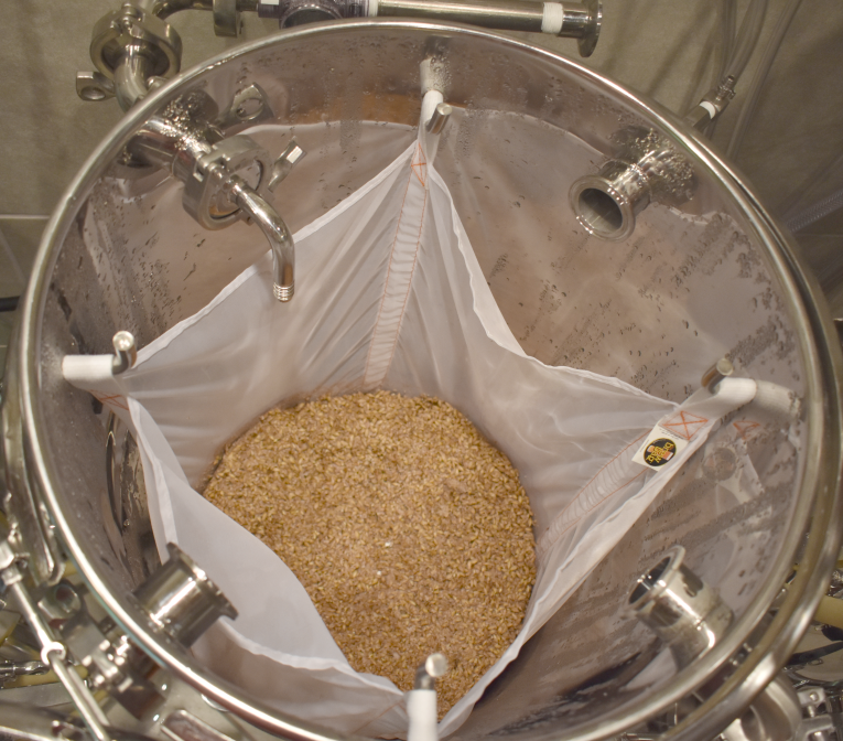SPENT GRAINS IN MASH BAG of a Low Oxygen Brewing System